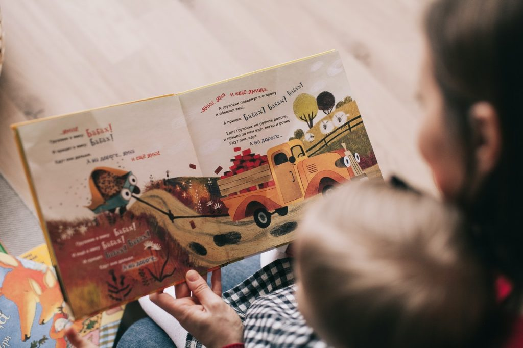 woman-reading-book-to-toddler