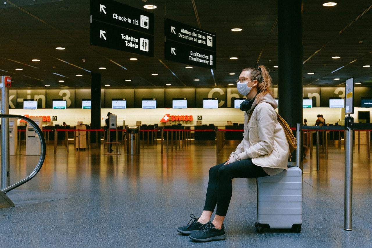 @Pexels woman-sitting-on-luggage