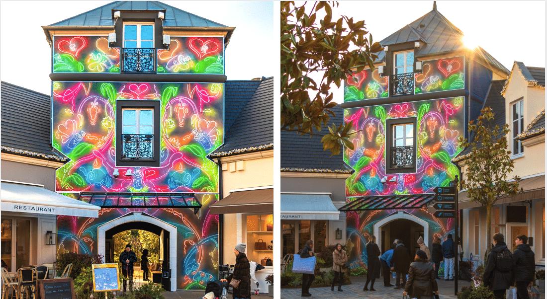 En exclu en France, le street artiste Straker pare les murs de La Vallée Village de couleurs fluo
