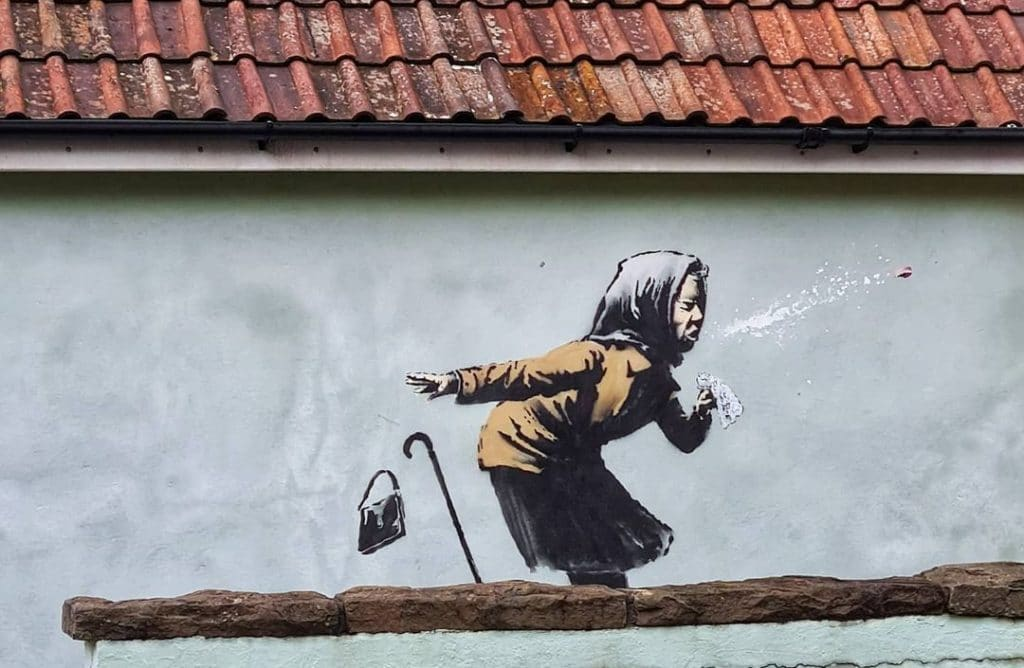 A New Banksy-Style Street Art Of A Sneezing Woman Has Appeared In Bristol UK