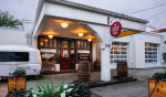 Prohibition-Style Speakeasy Opens In Renovated 1920s Gas Station