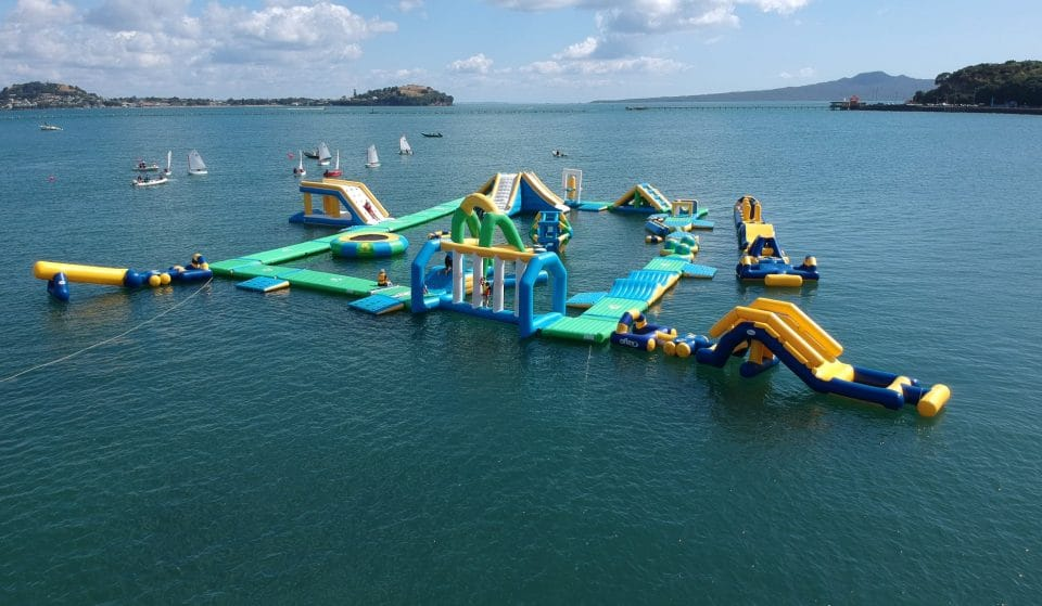A Massive Inflatable Water Course Is Hopping Around Auckland Beaches This Summer