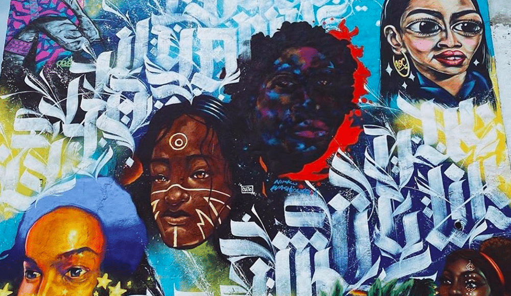 A Massive Mural Celebrating Black And Brown Unity Has Been Painted In Pilsen