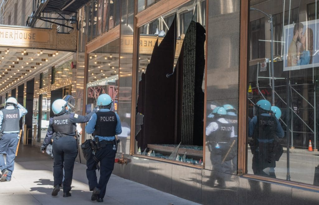Caution Sweeps Chicago As Businesses Board Up Storefronts And The National Guard Roll In