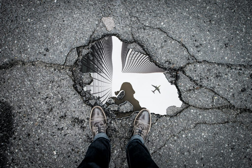 Rogers Park Artists Are Filling Potholes With Decorative Tiles And Used Bike Parts