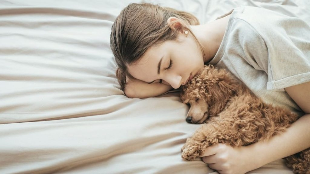 A New Study Claims Women Sleep Better With Their Dogs