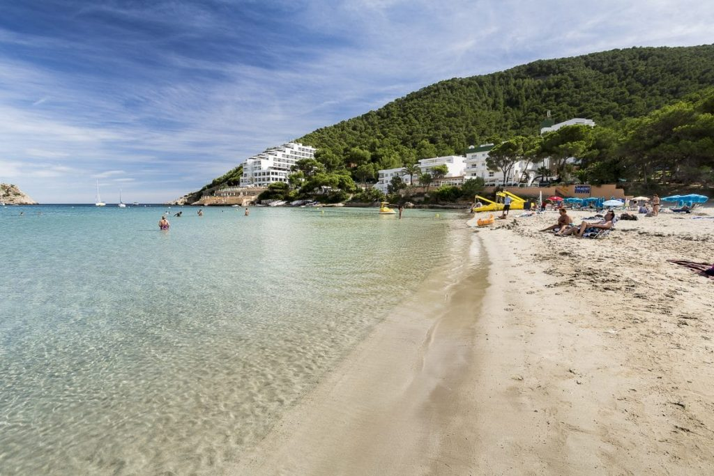 Get your fill of turquoise water, pine-tree hills and white sand at Cala Llonga