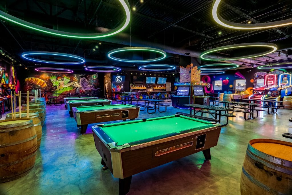 You Can Play Until You Drop At This 10,000-Square-Foot Arcade Covered In Murals