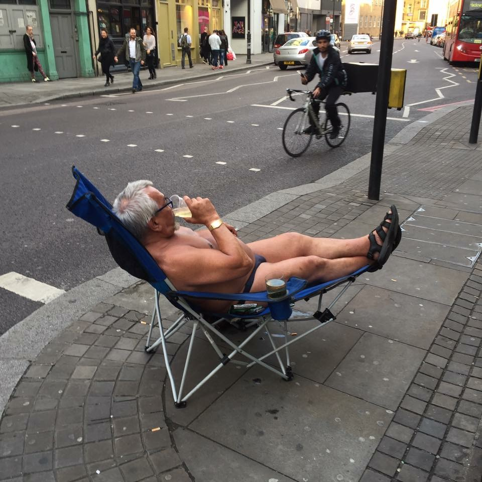 old man sunbatheing