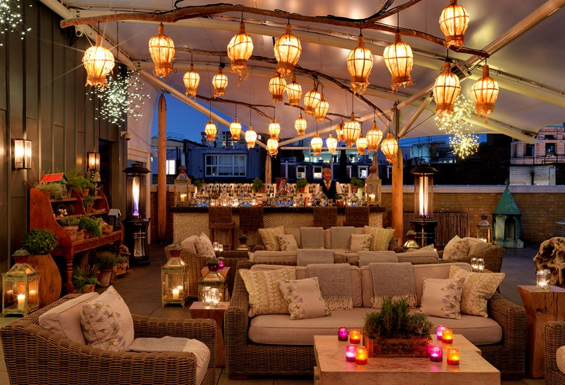 Drink Hot Gin Cocktails On A Cosy, Candlelit Roof Terrace