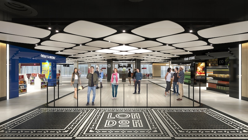 The new arrivals hall with fancy mosaic underfoot.