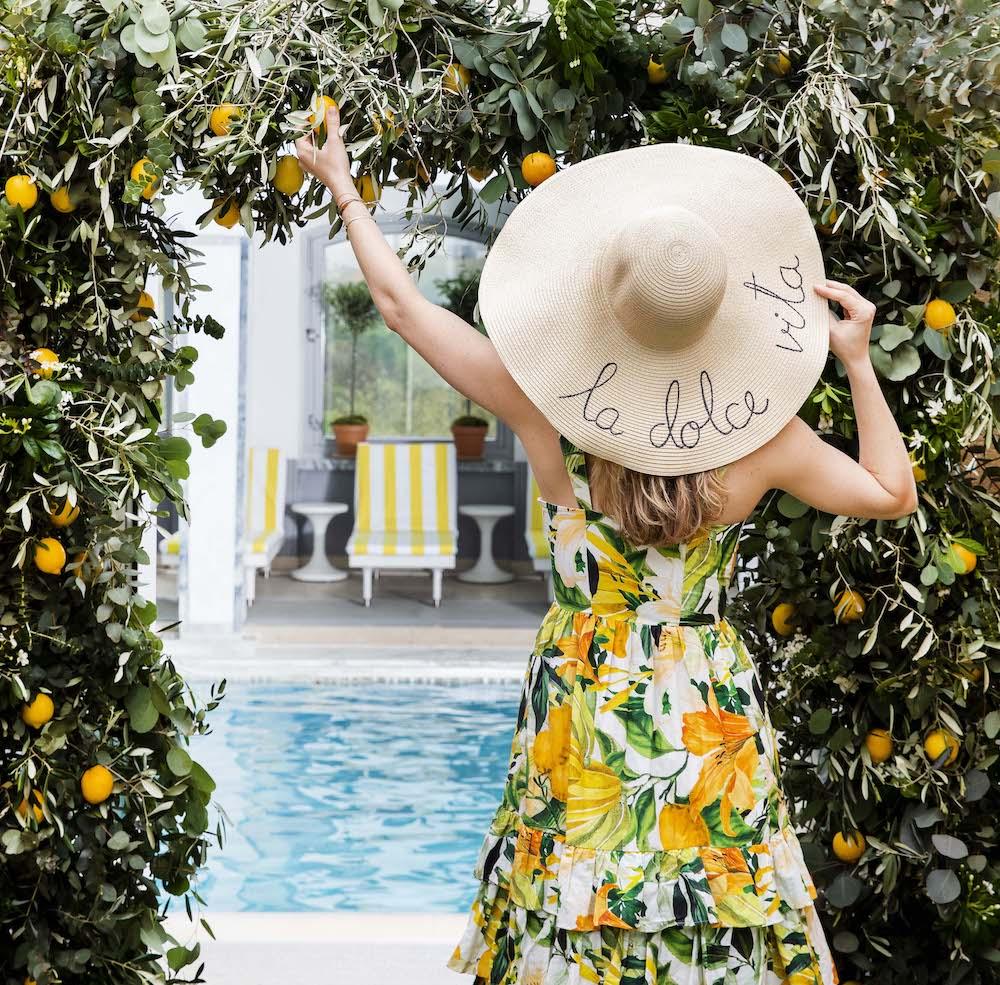 La Dolce Vita –girl posing in front of pool