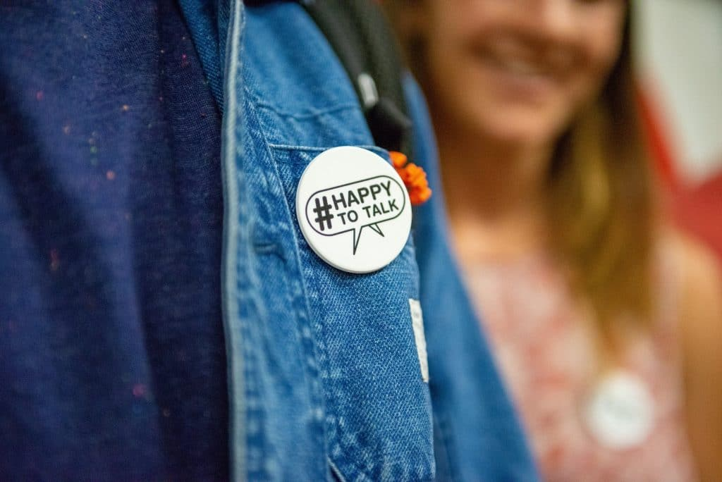 You Can Now Wear A Badge That Lets People Know You're 'Happy To Talk' On Public Transport