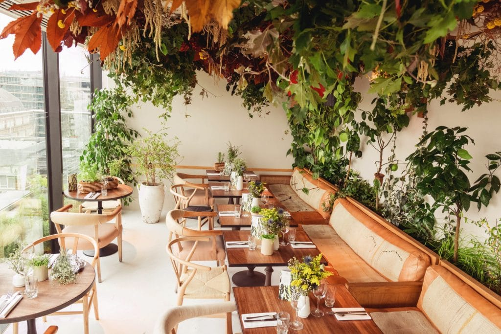 This Gorgeous, Foliage-Filled Restaurant Has Had A Seasonal Makeover