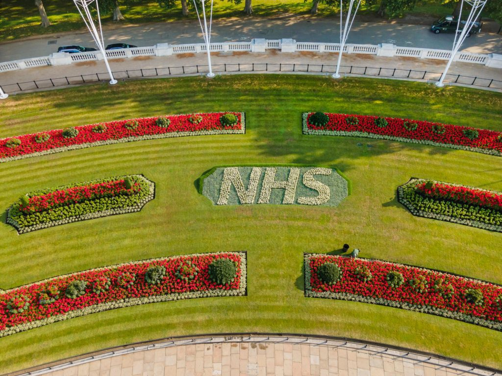 Buckingham Palace Thanks NHS Workers With Colourful Flowerbed Tribute