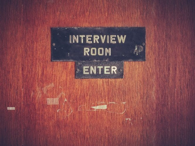 Door with sign saying Interview Room, Enter