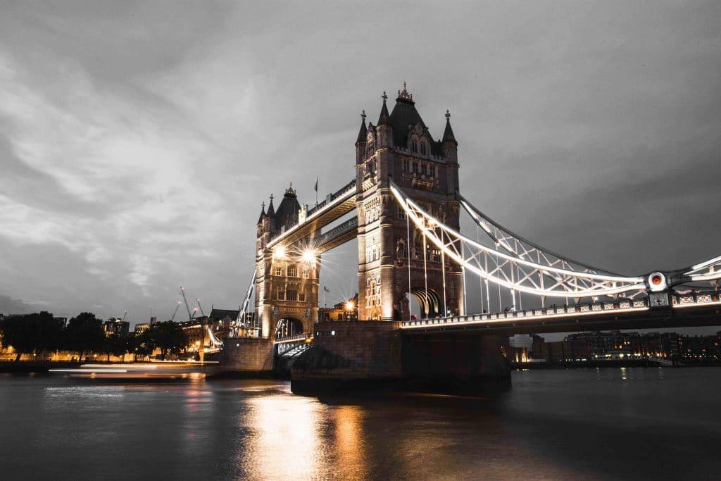 Tower Bridge, illuminated beneath grey skies for national day of reflection.