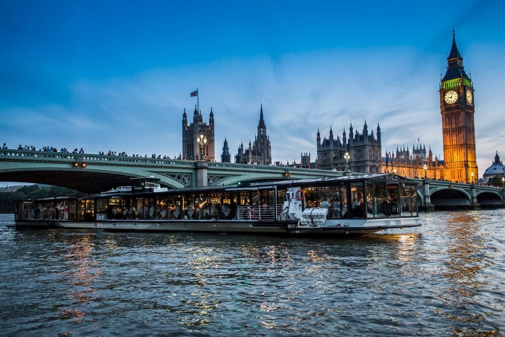 The Floating Candlelight Dinner cruise moves past Big Ben and the Houses of Parliament.