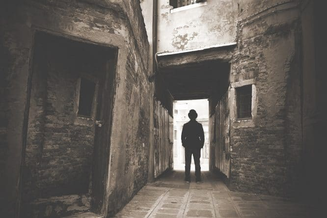 Man walking down a mystic dark alley