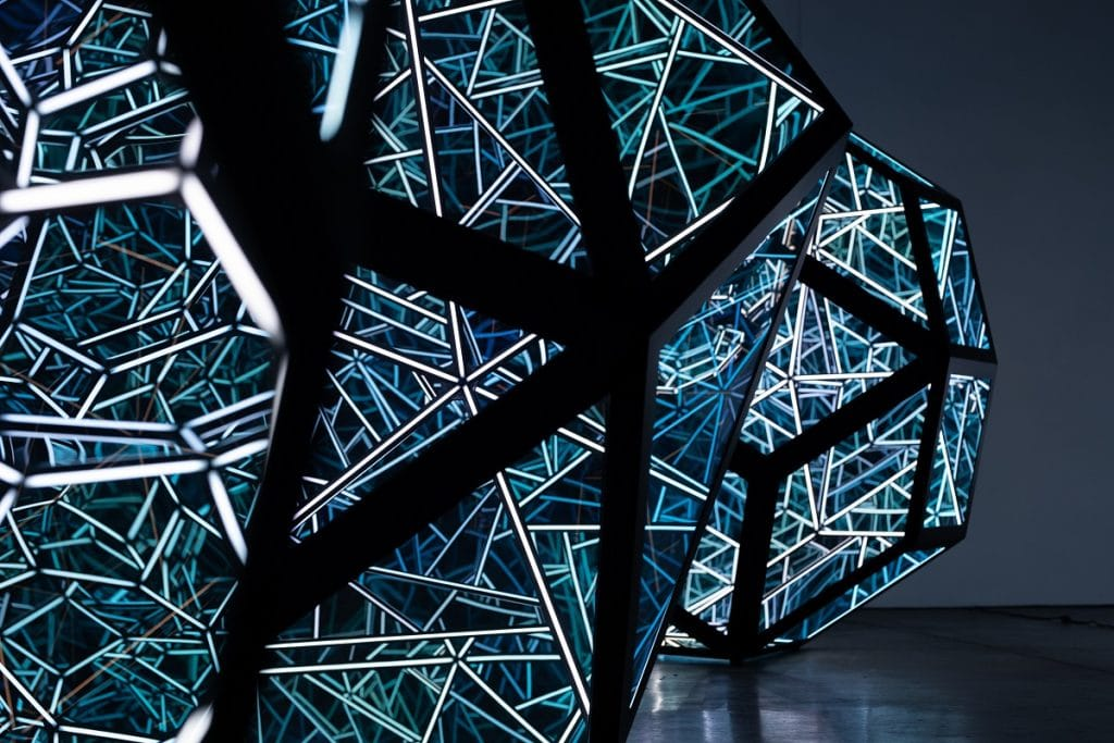 Two multi-faceted LED and glass shapes, as part of Anthony James' 'Constellations' artwork.
