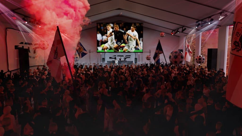 Fans gather in front of a big screen at the Euro 2020 fanpark
