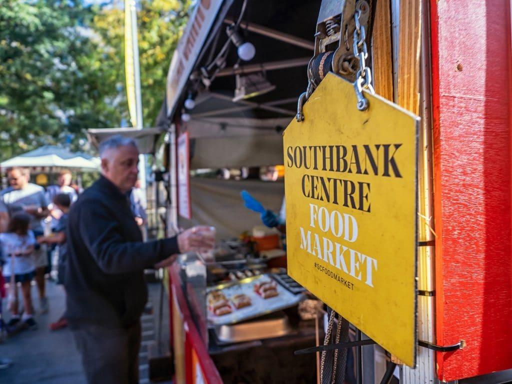 A man waits at a food stall at the Southbank Centre Food Market
