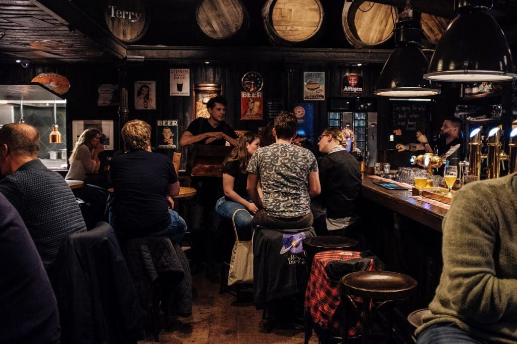 A group of people gathered inside a pub