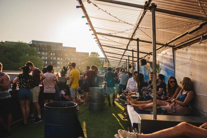 The sun sets over a terrace full of people at Model Market in Lewisham