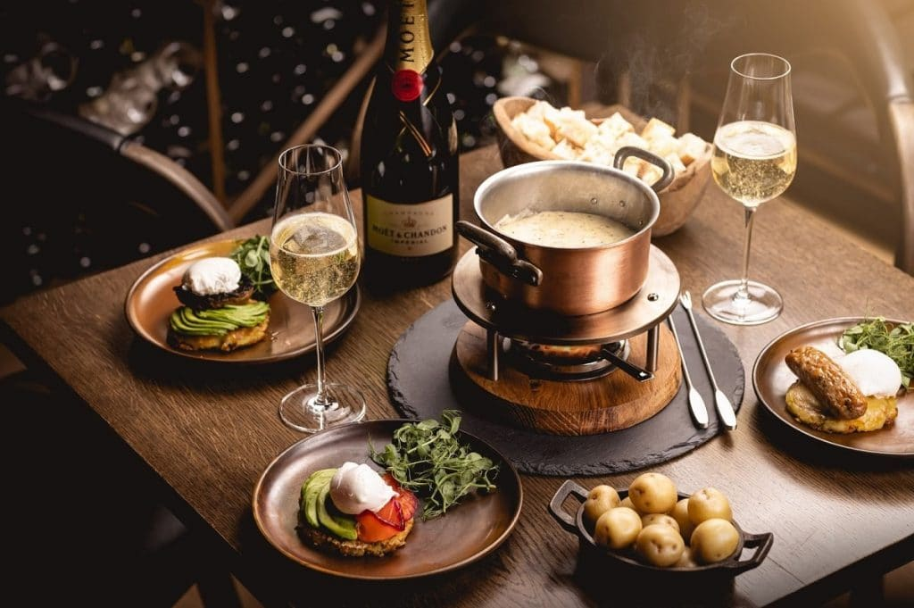Heritage Restaurant Serves Bottomless Brunch With Cheese And Chocolate Fondue