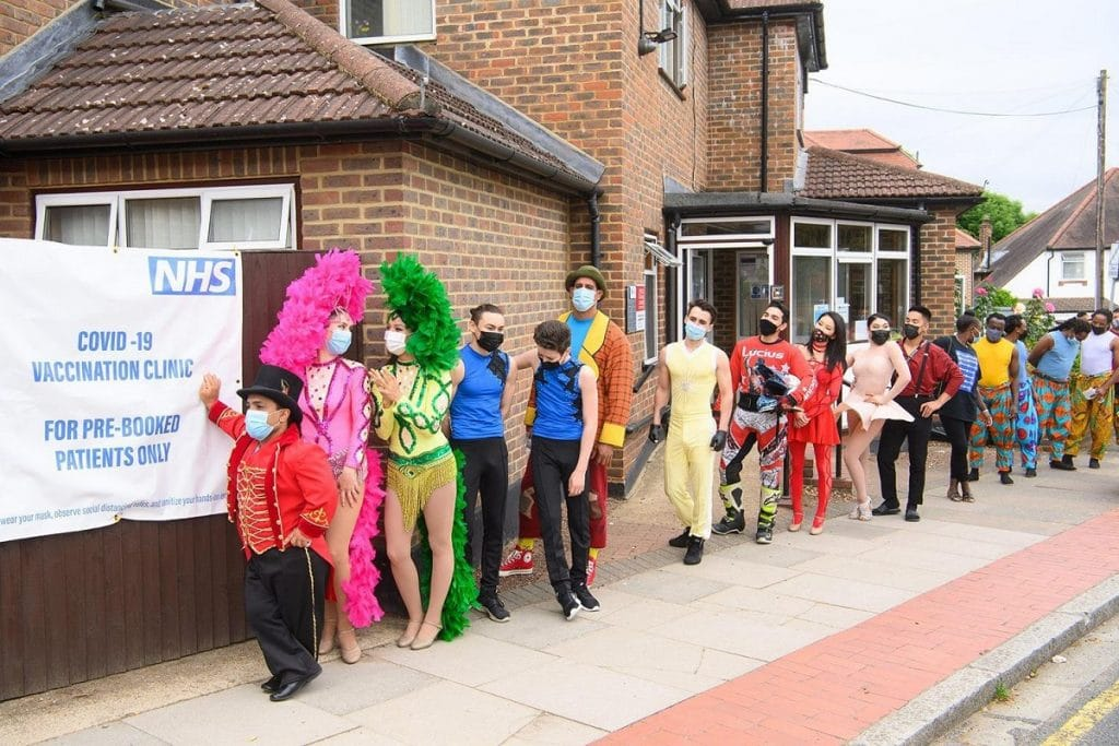 zippos circus performers line up in costume to get vaccinated