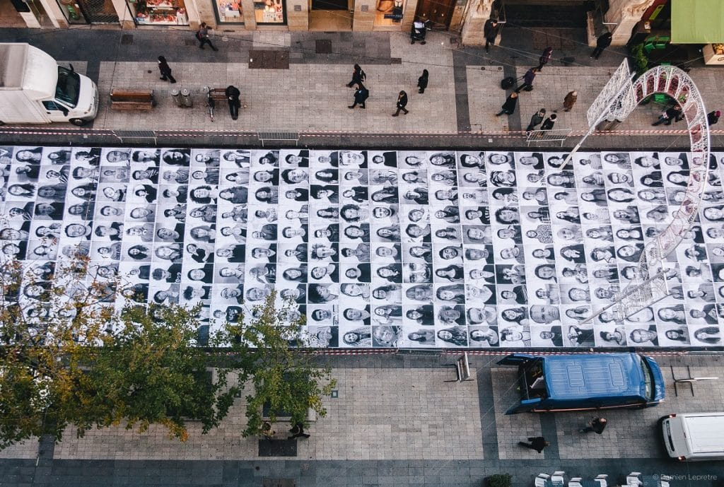 Portraits of faces on the street as part of the Inside Out Exhibition In Lyon France