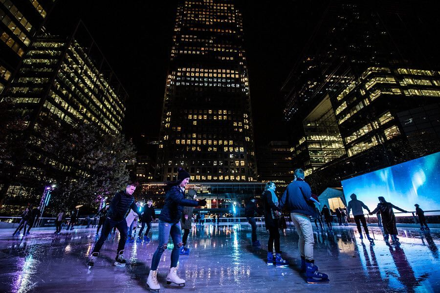 Skaters glide in the night air at the Canary Wharf ice rink.