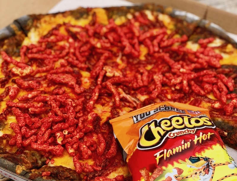 There's A Spooky Black Pizza Covered With Spicy Hot Cheetos In Hermosa Beach