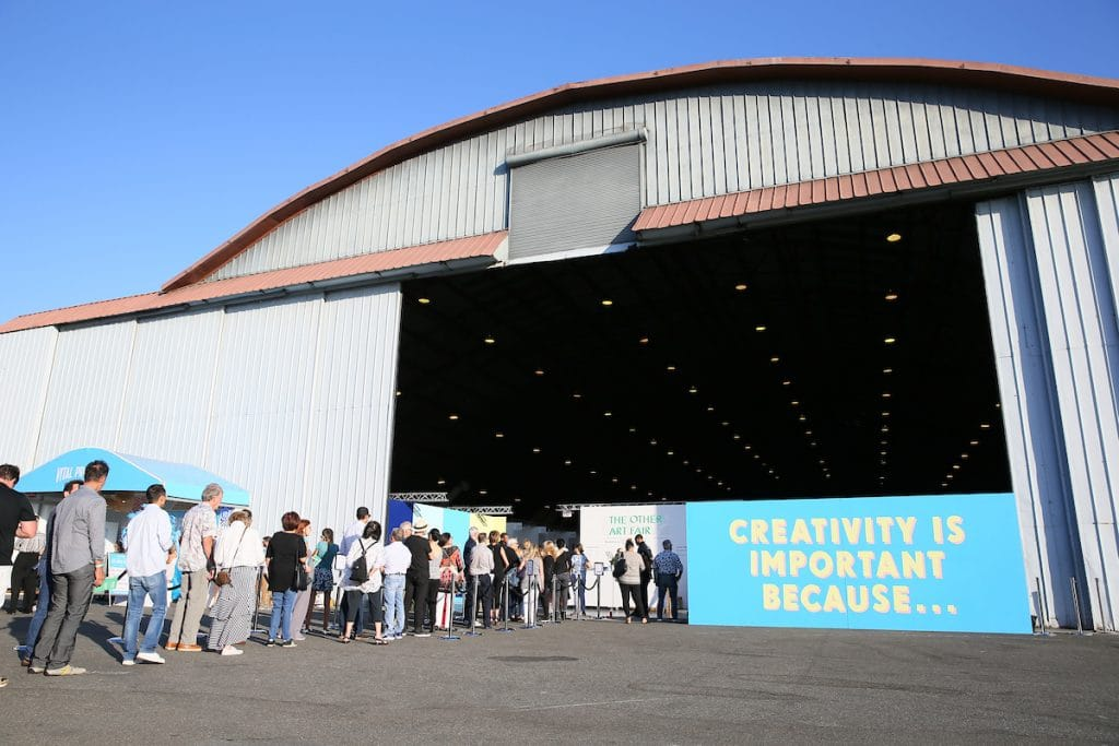 L.A.'s Eclectic 'The Other Art Fair' Returns To The Historic Barker Hangar This Month