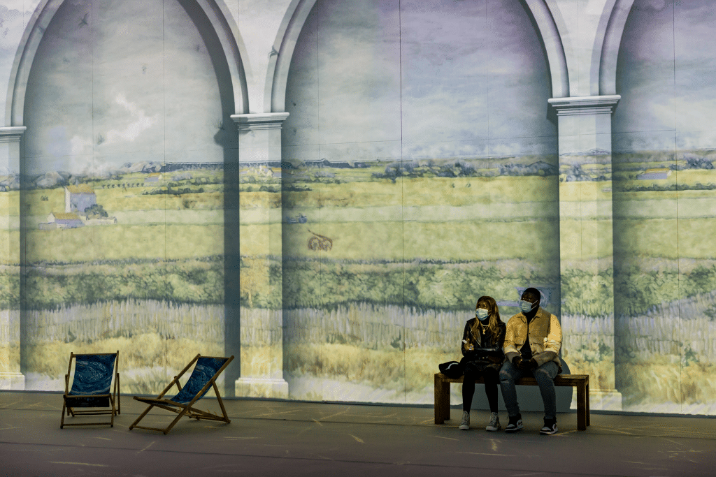 Van Gogh: The Immersive Experience exhibition. Image of Van Gogh's Wheatfield on walls and floor of museum.