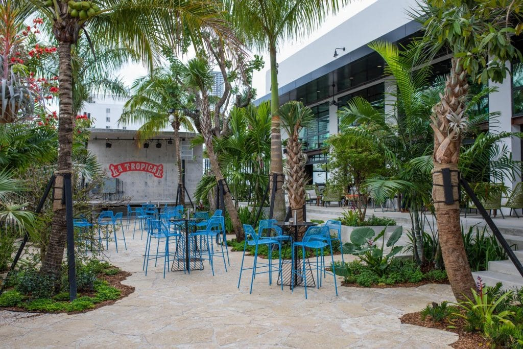Cuba's Oldest Brewery Has Finally Disembarked In Wynwood & It's A Tropical Paradise
