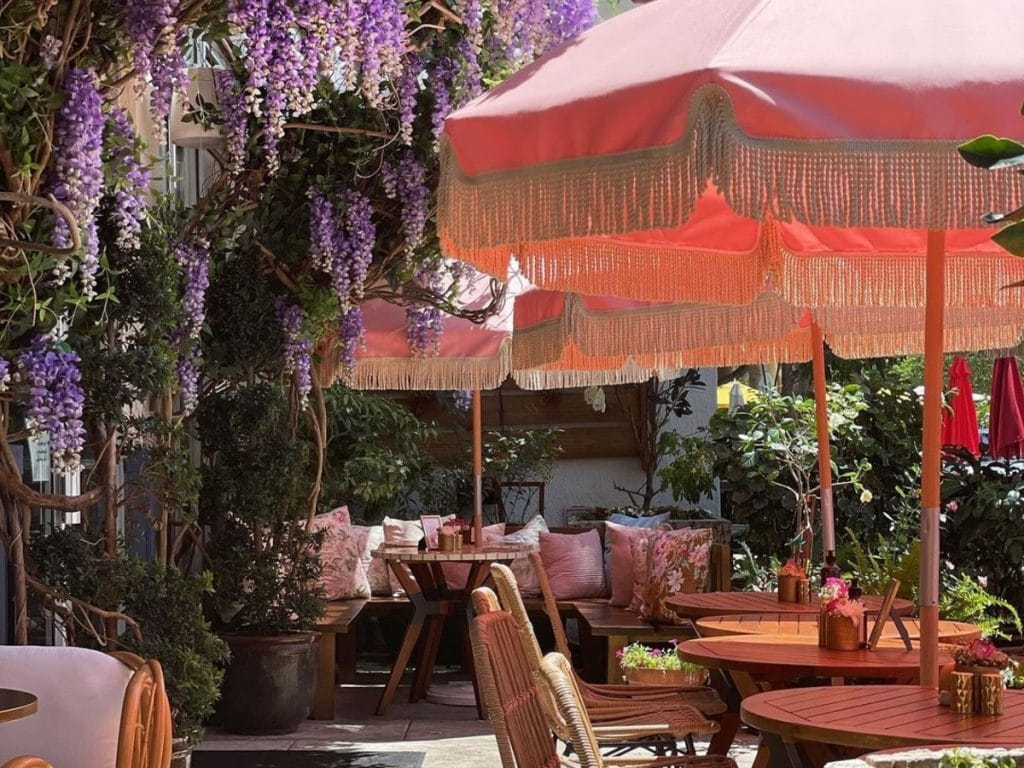 Enjoy A Luxurious Brunch At This Pretty, Wisteria-Clad Café In Midtown Miami