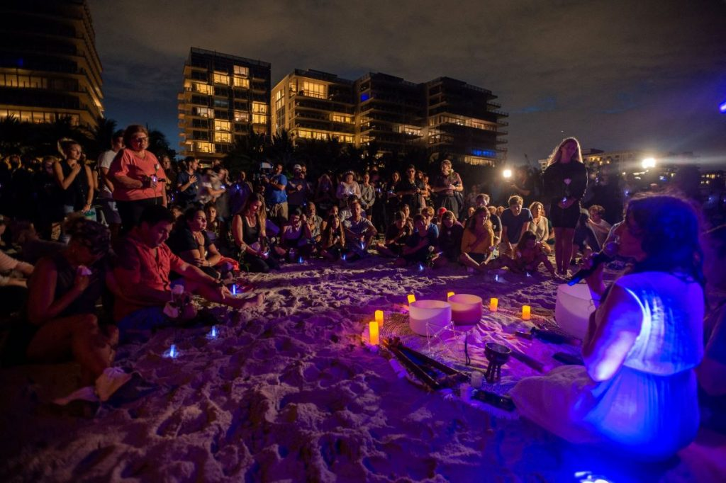 On Monday Night The Surfside Community Gathered At A Beach Vigil To Remember The Victims Of The Condo Collapse