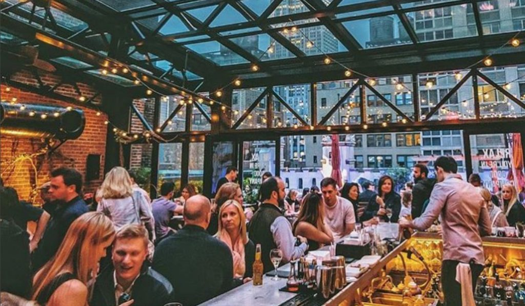Get Half Price Cocktails at This NYC Rooftop Bar on Monday, if You Wear a Hat!