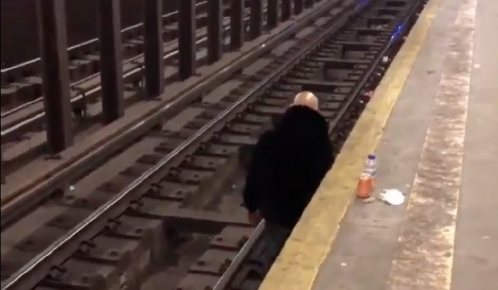Watch This Man Hang Out and Smoke a Cigarette Under NYC Tracks