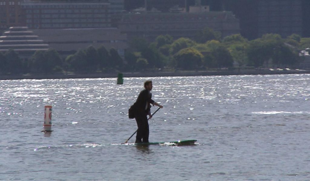 This Video Shows A Guy Paddle Boarding Across The Hudson In A Suit
