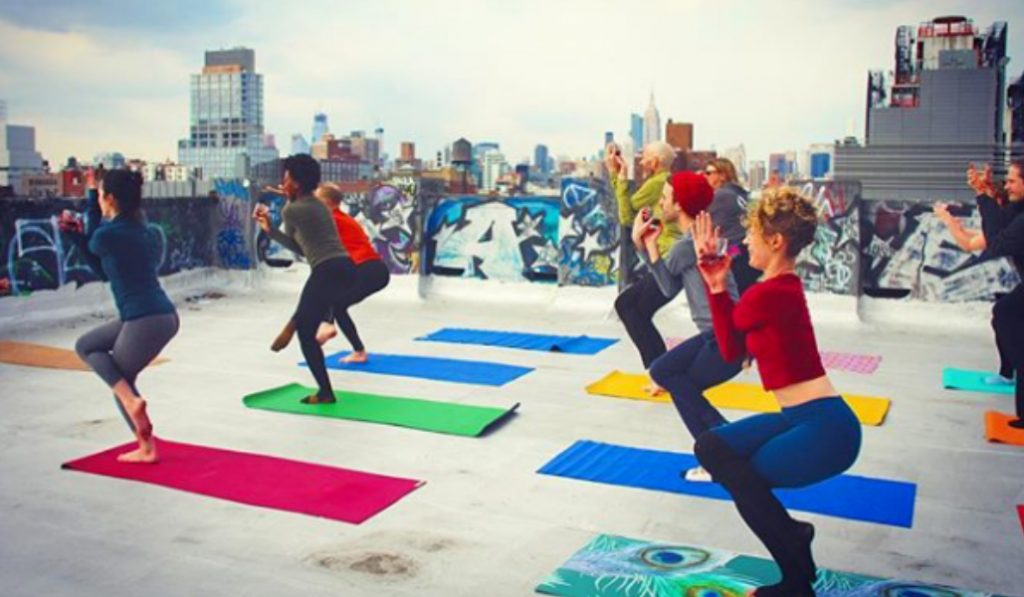 Wine-Down With This 'Drunk Yoga' Rooftop Class and Vino Happy Hour