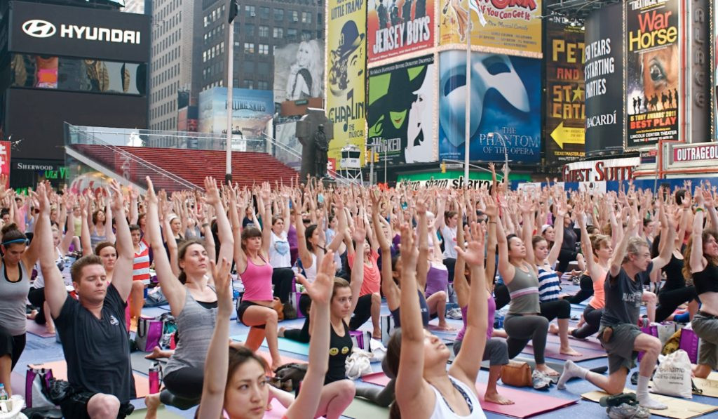Calling All Yogis, The Summer Solstice In Times Square Is Happening This Week