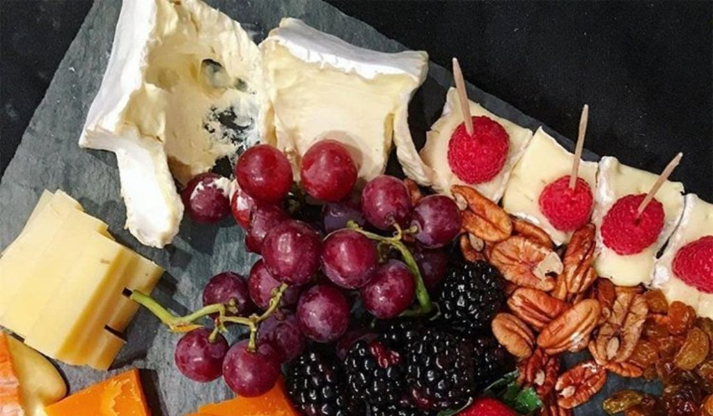 Let Your Parisian Dreams Come True At This French Cheese Shop In NYC