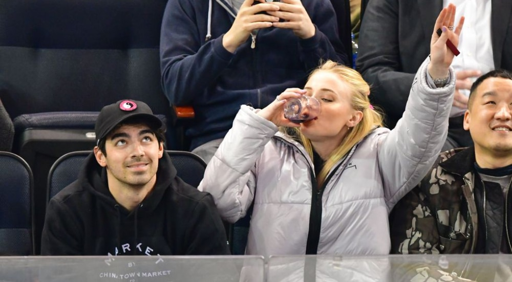 People Are Freaking Out Over This Video Of Sophie Turner Chugging Wine On A Jumbotron