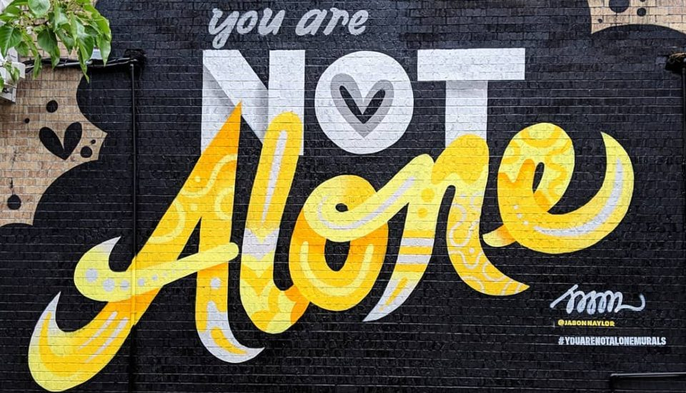 """All About The """"You Are Not Alone"""" Murals Popping Up Around NYC"""