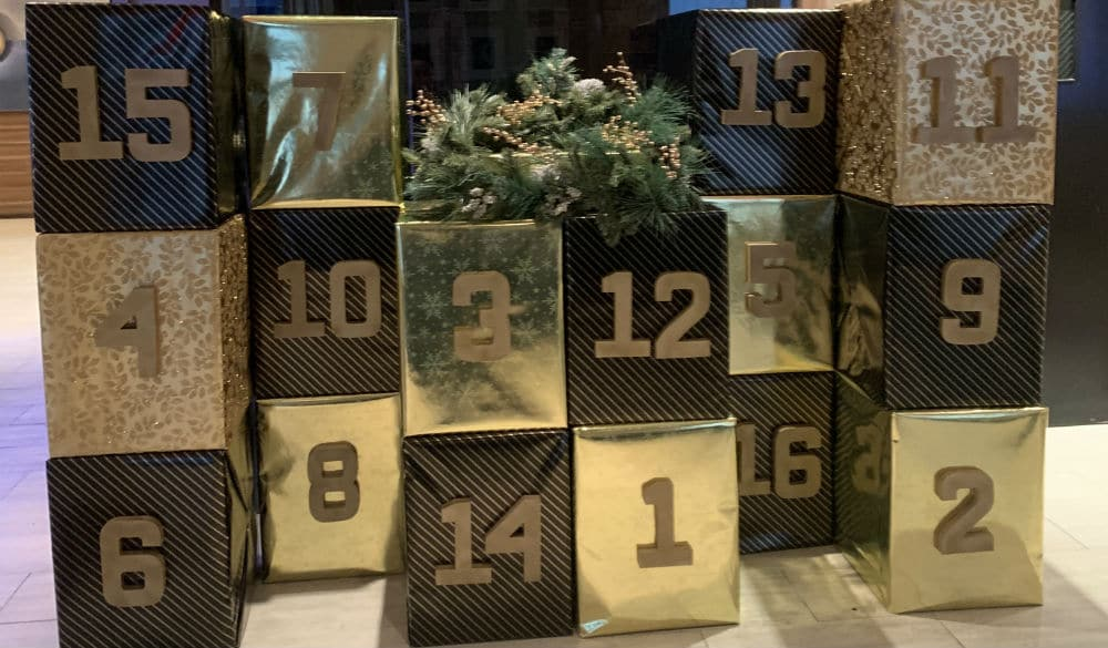 Score Free Gifts Every Day Of December At Midtown Life-Sized Advent Calendar