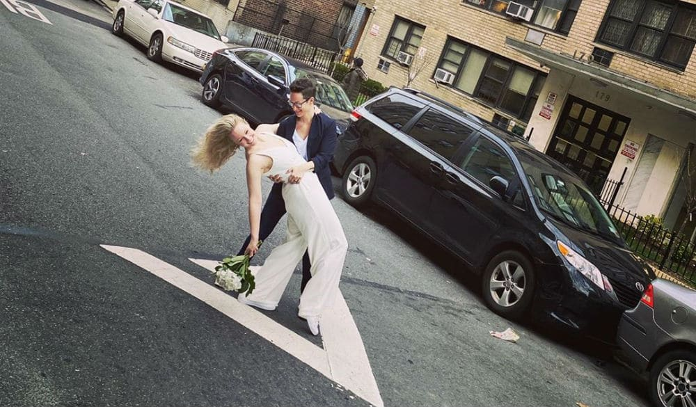 This NYC Couple Got Married While A Friend Officiated From His Fourth Floor Window