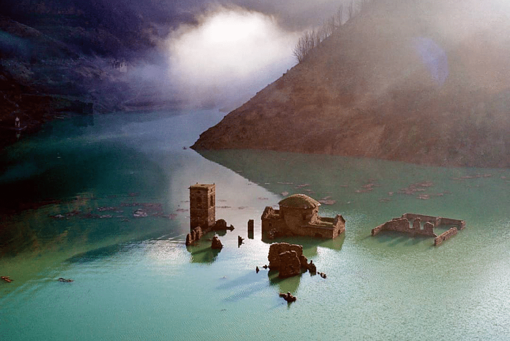 An Italian 'Ghost Town' Submerged Beneath A Lake Might Resurface Next Year