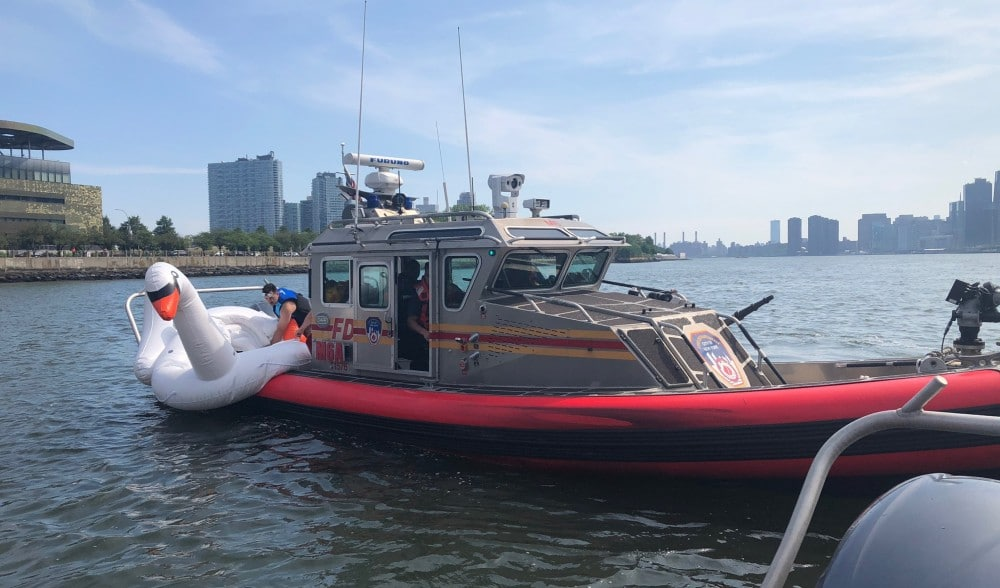 Two New Yorkers Had To Be Rescued While On A Giant Swan Float In The East River